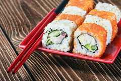 Seafood sushi and chopsticks Stock Images