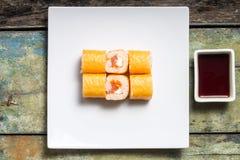 Seafood sushi rolls on weathered wood background. Royalty Free Stock Photo