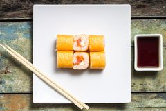 Seafood sushi rolls on weathered wood background. Royalty Free Stock Photos
