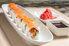 Seafood Sushi rolls in White Long Dish with soy sauce Royalty Free Stock Photography