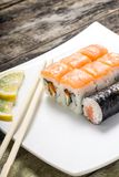 Seafood sushi rolls in white plate Royalty Free Stock Photography