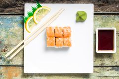 Seafood sushi rolls in white plate with chopsticks and japanese spices Stock Photography