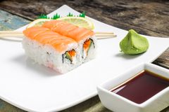 Seafood sushi rolls in white plate with chopsticks and japanese spices Stock Photos