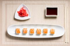 Seafood sushi rolls in white plate with chopsticks and japanese spices Royalty Free Stock Images