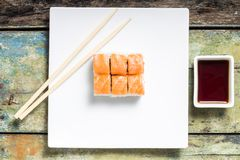 Seafood sushi rolls in white plate with chopsticks and japanese spices Royalty Free Stock Photo