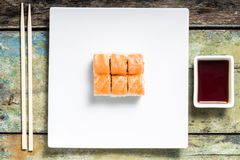 Seafood sushi rolls in white plate with chopsticks and spices Royalty Free Stock Photos