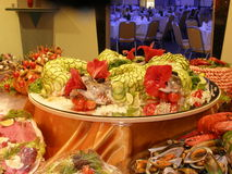 Seafood table with covered fish. Seafood table with cucumber covered fish Royalty Free Stock Image