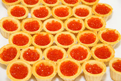 Seafood. Tartlets with red caviar. Royalty Free Stock Photos