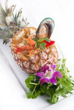 Seafood Thai curry in pineapple. Royalty Free Stock Photo