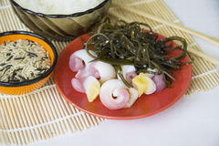 Seafood: trepangs and seaweed Royalty Free Stock Image