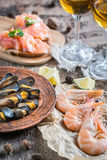 Seafood with two glasses of white wine on the wooden table Royalty Free Stock Photos