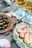 Seafood with two glasses of white wine on the wooden table Royalty Free Stock Photography