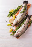 Seafood. Two raw rainbow trouts marinated with lime, rosemary Stock Photos