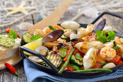 Seafood and vegetables Stock Images