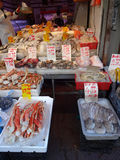 Seafood Vendor in Chinatown in New York City. Outdoor food vendor in Chinatown (New York City) selling crab legs, squid, clams, shrimp and other varieties of stock photo