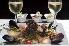 Seafood and white wine Stock Images