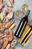 Seafood and white wine. Seafood. Oysters, lobster, clams and white wine. Top view on stone table Royalty Free Stock Photo