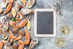 Seafood and white wine. Seafood. Oysters, lobster, clams and white wine. Top view on stone table with space for your text Stock Photo