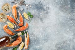 Seafood and white wine. Seafood. Oysters, lobster, clams and white wine. Top view on stone table with space for your text Royalty Free Stock Photography