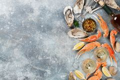 Seafood and white wine. Seafood. Oysters, lobster, clams and white wine. Top view on stone table with space for your text Royalty Free Stock Images