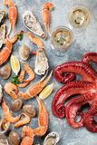 Seafood and wine. Octopus, lobster, shrimps. Seafood and wine. Octopus, oysters, lobster, shrimps and clams cooking. Top view Royalty Free Stock Photography