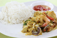 Seafood yellow curry powder stir Fried with steam rice Royalty Free Stock Photo