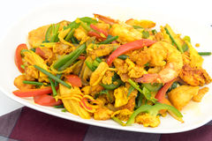 Seafood with Yellow curry sauce Royalty Free Stock Photo