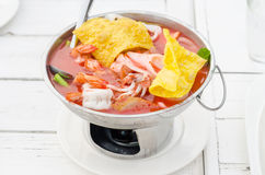 Seafood with yentafo soup serving in hot pot Royalty Free Stock Image