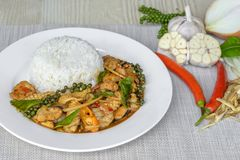 Seafoods cooked with thai spicy paste and thai harb. On white dish Stock Photo