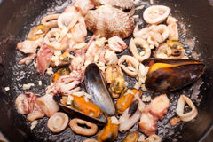 Seafoods on pan. Frying seafoods on pan, close-up Stock Photo