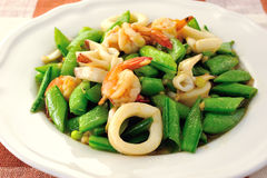 Seafoods - Shrimps,  Squids with green peas Royalty Free Stock Photo