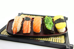The seafoods Sushi on the Black bamboo dish. Royalty Free Stock Images