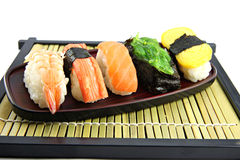 The seafoods Sushi on the Black bamboo dish. Stock Photography