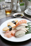 Seafoods Sushi on white dish in the restaurant. Seafoods Sushi on white dish in the restaurant,Traditional of Japanese Food Royalty Free Stock Photography