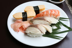Seafoods Sushi on white dish in the restaurant. Seafoods Sushi on white dish in the restaurant,Traditional of Japanese Food Royalty Free Stock Images