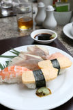 Seafoods Sushi on white dish in the restaurant. Seafoods Sushi on white dish in the restaurant,Traditional of Japanese Food Stock Image