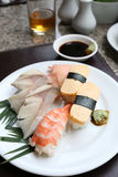 Seafoods Sushi on white dish in the restaurant. Seafoods Sushi on white dish in the restaurant,Traditional of Japanese Food Royalty Free Stock Photos