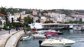 Seafront and boats on the dock of Saranda, Albania, beautiful cityscape stock photo