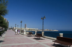 Seafront boulevard promenade sliema malta. With view of limestone beach and st. julians harbor with hotels and development Royalty Free Stock Image