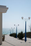 Seafront, boulevard by the sea with lanterns and thuja Royalty Free Stock Images