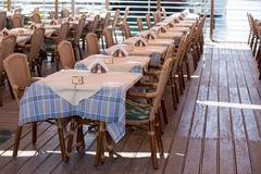 Seafront cafe tables rows Stock Photography