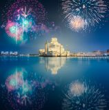 Seafront of Doha park and East Mound-Skyline view. During the night with fireworks and reflection on water, Qatar royalty free stock photography