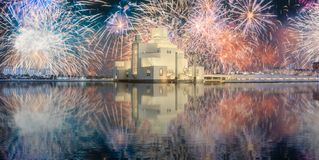 Seafront of Doha park and East Mound-Skyline view. During the night with fireworks and reflection on water, Qatar stock image