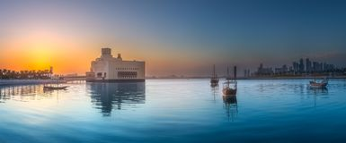Seafront of Doha park and East Mound-Skyline view. During purple sunset with boats, Qatar Royalty Free Stock Image