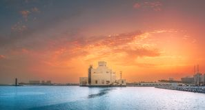 Seafront of Doha park and East Mound-Skyline view. During purple sunset, Qatar stock photo