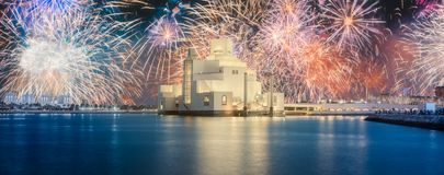 Seafront of Doha park and East Mound-Skyline view. During the night with fireworks, Qatar stock photography