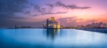 Seafront of Doha park and Museum of Islamic Art. During purple sunset, Qatar Royalty Free Stock Photos
