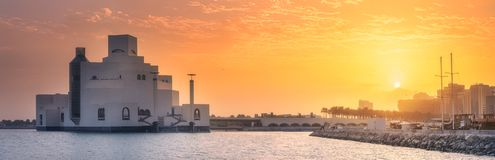 Seafront of Doha park and Museum of Islamic Art. During sunrise, Qatar Royalty Free Stock Photos