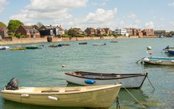 Seafront at Emsworth, Hampshire, England. Boats moored on seafront at Emsworth in Hampshire, England. With houses behind royalty free stock photo
