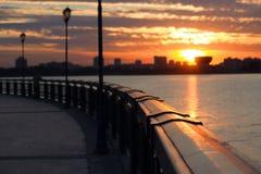Seafront fence sunrise Stock Photos